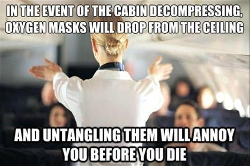 funny-pictures-plane-safty-untangling-oxygen-mask-before-die